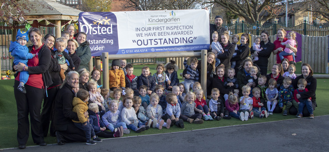 Staff and children at Harton Village Kindergarten celebrating our Outstanding grading.